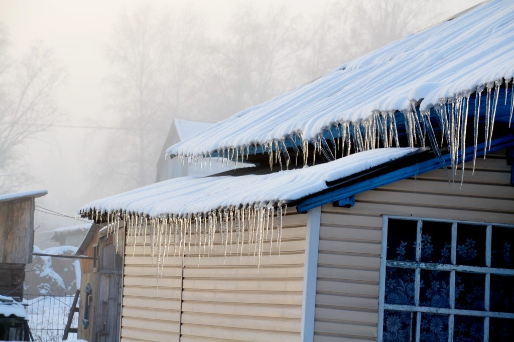 Ice Dam On Shingle Roof In Michigan Potentially Causing Roof Leaks